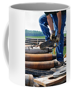 Coffee Mug featuring the photograph Metal On Metal by Carl Young