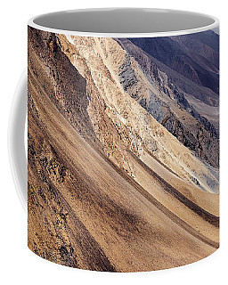 Coffee Mug featuring the photograph Mountainside by Whitney Goodey