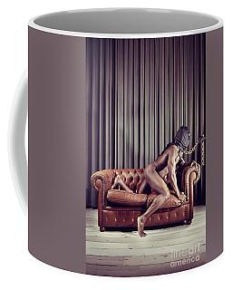 Naked Man With Mask On A Sofa Coffee Mug