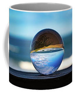 Coffee Mug featuring the photograph Ocean Through The Lens Ball by Lora J Wilson
