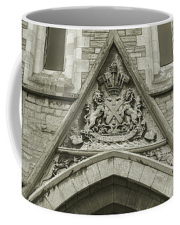Coffee Mug featuring the photograph Old Coat Of Arms On Plymouth Guildhall by Jacek Wojnarowski