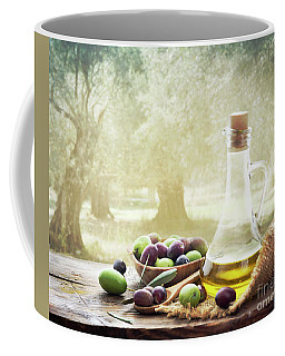Olives And Bottle Of Olive Oil On Wooden Table In Olive Garden Coffee Mug