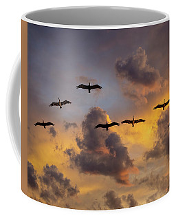 Coffee Mug featuring the photograph Pelicans In The Clouds by John Rodrigues