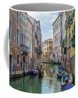 Coffee Mug featuring the photograph Gondolier On Canal Venice Italy by Nathan Bush