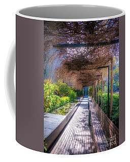 Coffee Mug featuring the photograph Picture Of Rest Area With Wood Bench, Water Feature And Plenty O by PorqueNo Studios