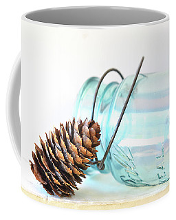 Coffee Mug featuring the photograph Pine Cone And A Jar by Michelle Wermuth