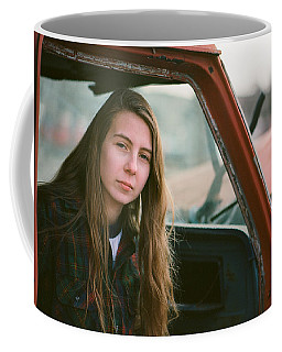 Coffee Mug featuring the photograph Portrait In A Truck by Carl Young