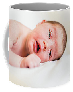Portrait Of Newborn Baby Girl Feels Safe And Awake To A New Life. Coffee Mug