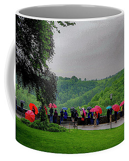 Coffee Mug featuring the photograph Rainy Day Umbrellas by Phyllis Spoor