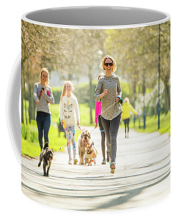 Running With Her Dog In The Park Coffee Mug