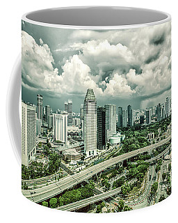 Coffee Mug featuring the photograph Singapore by Chris Cousins
