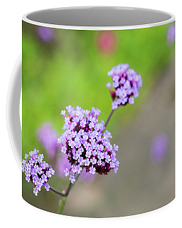 Coffee Mug featuring the photograph Small Purple Flowers by Scott Lyons