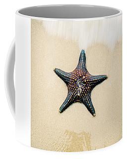 Starfish On The Beach Sand. Close Up. Coffee Mug