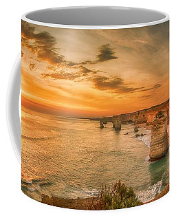 Coffee Mug featuring the photograph Sunset At The Twelve Apostles by Chris Cousins