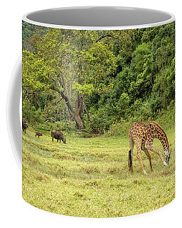 Coffee Mug featuring the photograph The Giraffe And The Cape Buffalo by Kay Brewer