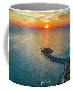 Coffee Mug featuring the photograph The Last Ray by Michael Hughes