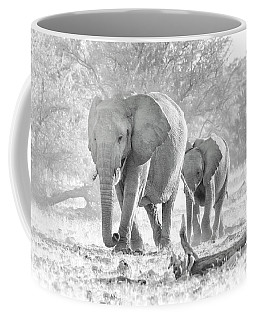 Coffee Mug featuring the photograph To The Watering Hole by Rand