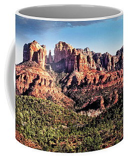 Coffee Mug featuring the photograph Towering Red Rocks by Scott Kemper