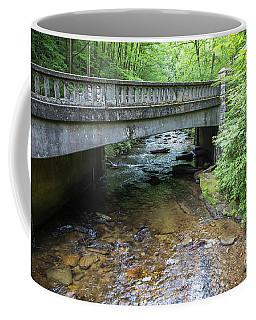 Water Flowing Beneath A Rustic Bridge Coffee Mug