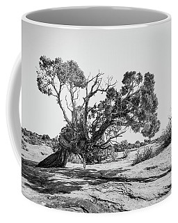 Coffee Mug featuring the photograph Will To Survive by Andy Crawford
