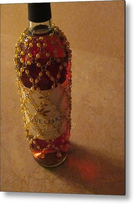 The White Wine Bottle In Its Netting Casts A Red Ethereal Glow On The Metal Prints