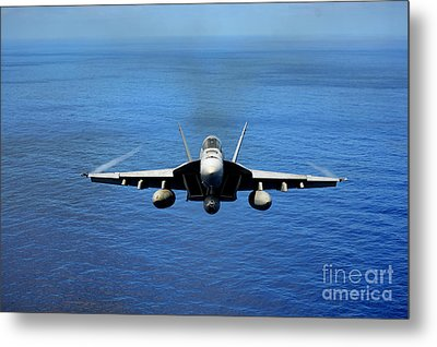 Metal Print featuring the photograph  A Fa-18 Hornet Demonstrates Air Power. by Paul Fearn