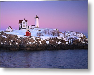 Nubble Light Under A Pastel Winter Sky Metal Print by Jeff Sinon