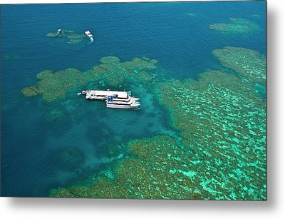 Aerial View Of A Tour Boat Docked Metal Print by Miva Stock