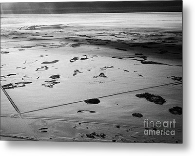 aerial view of snow covered prairies and remote isolated farmland in Saskatchewan Canada Metal Print by Joe Fox