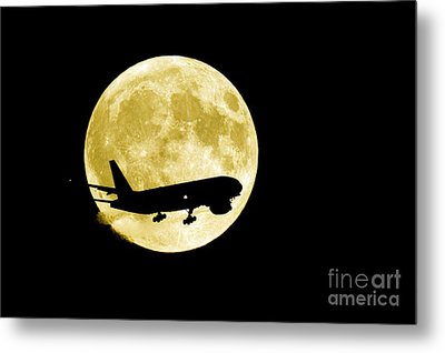 Airplane Silhouetted Against A Full Moon Metal Print by David Nunuk