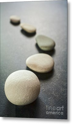 Curving Line Of Grey Pebbles On Dark Background Metal Print