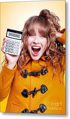 Excited Winter Woman Holding Savings Calculator Metal Print by Jorgo Photography - Wall Art Gallery
