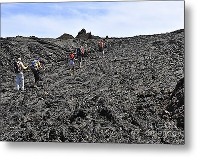 Group Of Hickers Walking On Cooled Lava Metal Print by Sami Sarkis