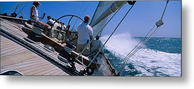 Group Of People Racing In A Sailboat Metal Print by Panoramic Images