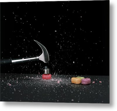 Hammer Smashing A Boiled Sweet On Surface Metal Print by Dorling Kindersley/uig