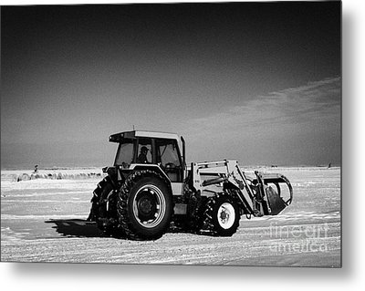 international 5140 tractor with front end loader on frozen field Forget Saskatchewan Canada Metal Print by Joe Fox