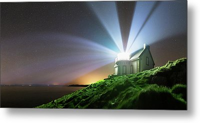 Lighthouse Beams At Night Metal Print by Laurent Laveder