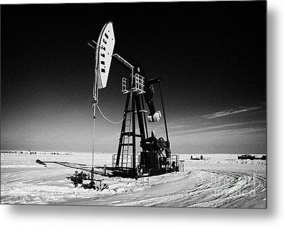 oil pumpjack in winter snow Forget Saskatchewan Canada Metal Print