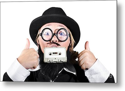 Person Holding Cassette In Mouth With Showing Thumb Up Sign Metal Print by Jorgo Photography - Wall Art Gallery
