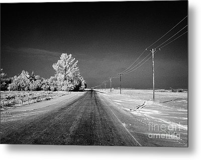 salt and grit covered rural small road in Forget Saskatchewan Canada Metal Print by Joe Fox