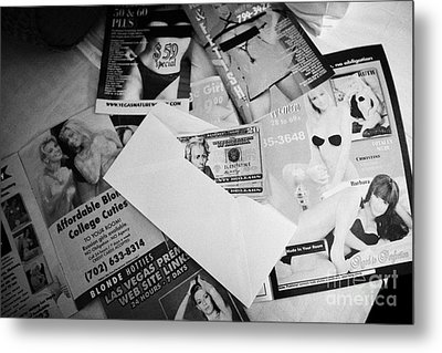 Selection Of Leaflets Advertising Girls Laid Out On A Hotel Bed With Us Dollars Cash In An Envelope  Metal Print by Joe Fox