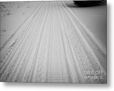 snowmobile tracks in the snow Kamsack Saskatchewan Canada Metal Print