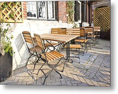 Tables And Chairs Metal Print by Tom Gowanlock