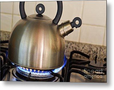 Teapot On Gas Stove Burner Metal Print by Sami Sarkis