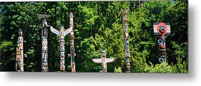 Totem Poles In A A Park, Stanley Park Metal Print by Panoramic Images