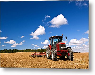 Tractor In Plowed Field Metal Print by Elena Elisseeva