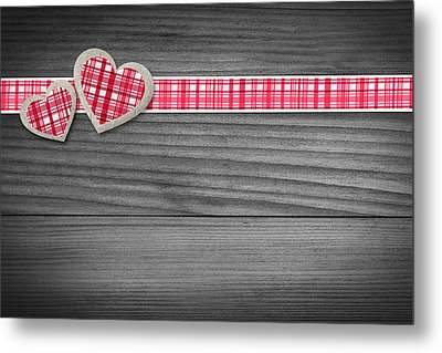 Two Hearts Laying On Wood  Metal Print by Aged Pixel