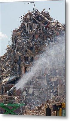 Water Spraying At Demolition Site Metal Print by Jim West