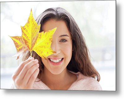 Woman Holding Leaf In Front Of Face Metal Print by Ian Hooton