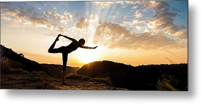 Woman Performing Standing Bow Pulling Metal Print by Panoramic Images